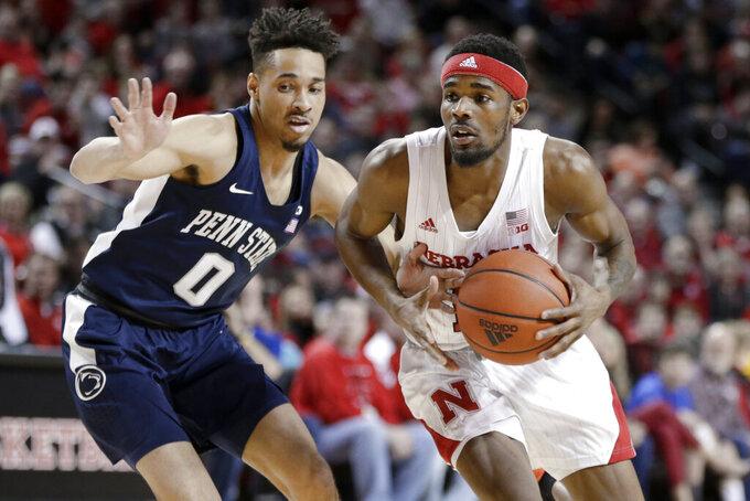Nebraska's Dachon Burke Jr., right, tries to get around Penn State's Myreon Jones (0) during the first half of an NCAA college basketball game in Lincoln, Neb., Saturday, Feb. 1, 2020. (AP Photo/Nati Harnik)