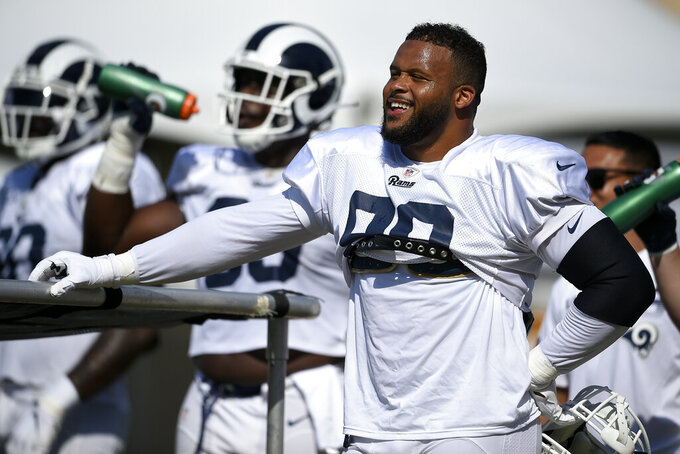 FILE - In this July 30, 2019, file photo, Los Angeles Rams defensive end Aaron Donald is shown during an NFL football training camp, in Irvine, Calif.  Todd Gurley, Aaron Donald and now Jared Goff have all agreed to contract extensions over the past year that set new NFL benchmarks for guaranteed money at their respective positions.  (AP Photo/Kelvin Kuo, File)