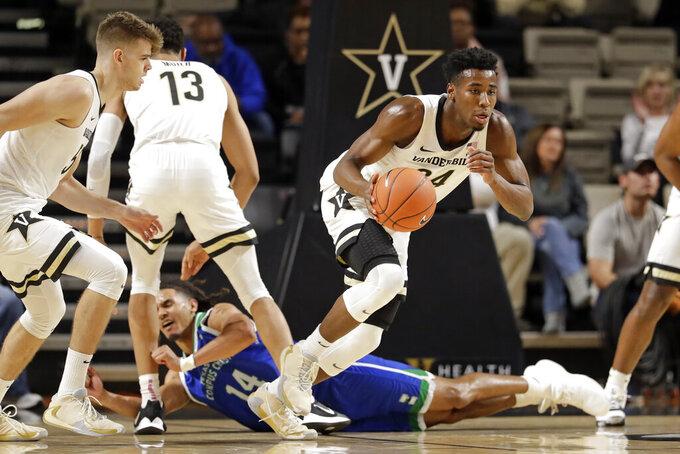 Vanderbilt forward Aaron Nesmith (24) heads down the court after taking the ball from Texas A&M-Corpus Christi forward Elijah Schmidt (14) in the first half of an NCAA college basketball game Monday, Nov. 11, 2019, in Nashville, Tenn. (AP Photo/Mark Humphrey)