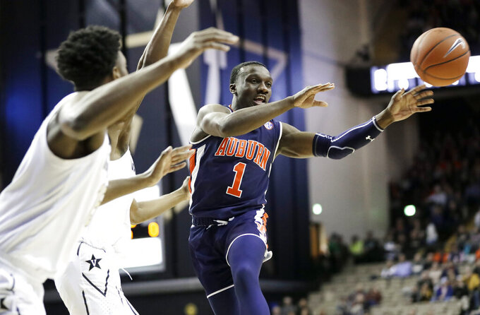 Auburn Tigers guard Jared Harper (1) passes the ball against Vanderbilt in the first half of an NCAA college basketball game Saturday, Feb. 16, 2019, in Nashville, Tenn. (AP Photo/Mark Humphrey)