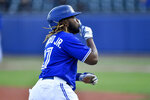 Toronto Blue Jays' Vladimir Guerrero Jr. gestures as he rounds the bases after hitting a three-run home run against the Miami Marlins during the third inning of a baseball game in Buffalo, N.Y., Tuesday, June 1, 2021. (AP Photo/Adrian Kraus)