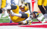 Iowa defensive back Geno Stone (9) comes down with an interception in the end zone during the second half of an NCAA college football game against Indiana, Saturday, Oct. 13, 2018, in Bloomington, Ind. Iowa won 42-16. (AP Photo/Doug McSchooler)