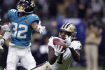 New Orleans Saints wide receiver Marquez Callaway (1) pulls in a touchdown reception against Jacksonville Jaguars cornerback Tyson Campbell (32) in the first half of an NFL preseason football game in New Orleans, Monday, Aug. 23, 2021. (AP Photo/Brett Duke)