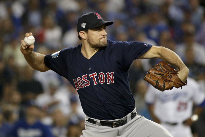 FILE - In this Oct. 26, 2018, file photo, Boston Red Sox starting pitcher Nathan Eovaldi throws against the Los Angeles Dodgers during the 12th inning in Game 3 of the World Series baseball game in Los Angeles. Eovaldi's marathon relief performance in Game 3 is a moment that will resonate in Red Sox history. Boston rewarded him with a $68 million, four-year contract. (AP Photo/Jae C. Hong, File)