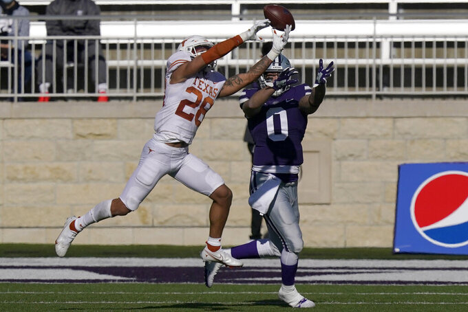 Texas defensive back Jerrin Thompson (28) breaks up a pass intended for Kansas State tight end Briley Moore (0) during the first half of an NCAA college football game in Manhattan, Kan., Saturday, Dec. 5, 2020. (AP Photo/Orlin Wagner)