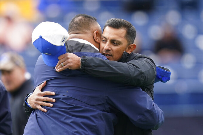 BYU head coach Kalani Sitake, left, receives a hug from Boise State head coach Andy Avalos before an NCAA college football game Saturday, Oct. 9, 2021, in Provo, Utah. (AP Photo/Rick Bowmer)
