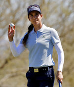 Azahara Munoz waves to the crowd on the 18th green during the third round of the Founders Cup LPGA golf tournament, Saturday, March 23, 2019, in Phoenix. (AP Photo/Matt York)