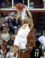 Texas forward Jaxson Hayes (10) scores over Baylor guard Mark Vital (11) during the first half on an NCAA college basketball game Wednesday, Feb. 6, 2019, in Austin, Texas. (AP Photo/Eric Gay)