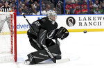 Tampa Bay Lightning goaltender Andrei Vasilevskiy (88) makes a save during the first period of an NHL hockey game against the Washington Capitals Saturday, March 16, 2019, in Tampa, Fla. (AP Photo/Jason Behnken)