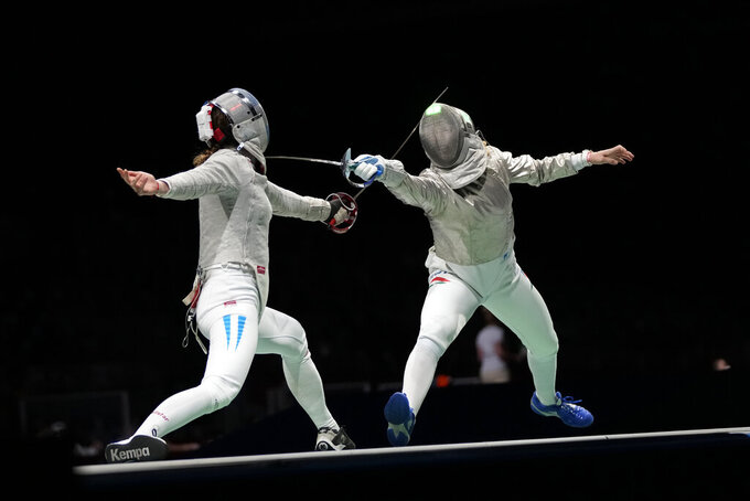 Maria Belen Perez Maurice of Argentina, left, and Anna Marton of Hungary compete in the women's individual round of 32 Sabre competition at the 2020 Summer Olympics, Monday, July 26, 2021, in Chiba, Japan. (AP Photo/Hassan Ammar)