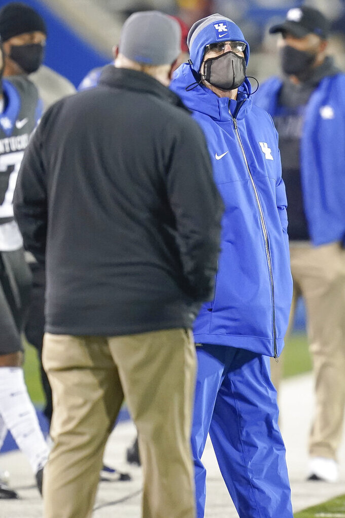 Kentucky offensive coordinator Eddie Grand stands on the field during the second half of an NCAA college football game against South Carolina, Saturday, Dec. 5, 2020, in Lexington, Ky. (AP Photo/Bryan Woolston)
