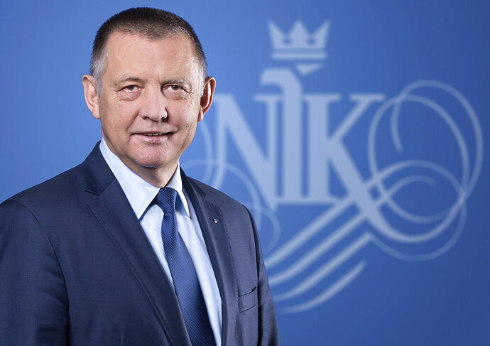 This undated handout photo provided by Poland's Supreme Audit Office shows an official photograph of the office's president, Marian Banas. Poland's ruling right-wing party begins its second term caught up in a crisis over Banas, who faces allegations of wrongdoing but refuses to resign and cannot easily be removed from his job. (Marek Brzeziński/Supreme Audit Office via AP)