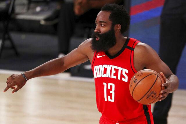 Houston Rockets James Harden (13)  dribbles the ball against the Dallas Mavericks during the second half of an NBA basketball game Friday, July 31, 2020, in Lake Buena Vista, Fla. (Mike Ehrmann/Pool Photo via AP)