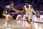 Tennessee guard Jordan Bowden (23) drives against Chattanooga guard Jonathan Scott (1) during the first half of an NCAA college basketball game Monday, Nov. 25, 2019, in Knoxville, Tenn. (AP Photo/Wade Payne)