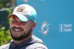 Miami Dolphins guard Durval Queiroz Neto, of Brazil, smiles as he speaks to members of the media after a practice at the NFL football team's new training facility, Friday, Aug. 6, 2021, in Miami Gardens, Fla. (AP Photo/Wilfredo Lee)