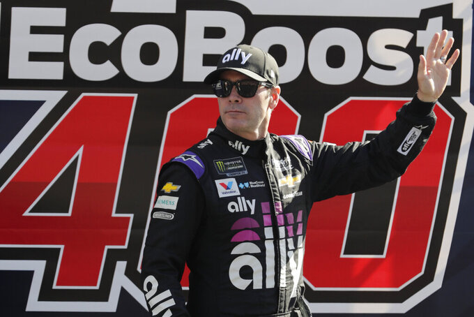 Jimmie Johnson waves during driver introduction before a NASCAR Cup Series auto race at Homestead-Miami Speedway in Homestead, Fla., Sunday, Nov. 17, 2019. (AP Photo/Luis M. Alvarez)