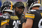 Pittsburgh Steelers' Mike Tomlin, center, talks with T.J. Watt (90) during the second half of an NFL football game against the Buffalo Bills in Orchard Park, N.Y., Sunday, Sept. 12, 2021. (AP Photo/Joshua Bessex)