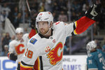 Calgary Flames center Elias Lindholm (28) celebrates after scoring a goal against the San Jose Sharks during the second period of an NHL hockey game in San Jose, Calif., Sunday, Oct. 13, 2019. (AP Photo/Jeff Chiu)