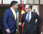 German Foreign Minister Heiko Maas, right, talks with his North Macedonia's counterpart Nikola Dimitrov, after their meeting in Skopje, North Macedonia, on Wednesday, Nov. 13, 2019. Maas arrived Wednesday in Skopje to discuss with his counterpart Nikola Dimitrov the bilateral relations and the further steps after North Macedonia has failed to open the membership talks with European Union last month. (AP Photo/Boris Grdanoski)