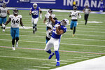 Indianapolis Colts' Jonathan Taylor (28) makes a catch against Jacksonville Jaguars' Chris Claybrooks (27) during the first half of an NFL football game, Sunday, Jan. 3, 2021, in Indianapolis. (AP Photo/AJ Mast)