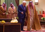 FILE - In this Wednesday, Dec. 20, 2017, file photo released by Al-Ekhbariya, Saudi King Salman, right, receives Palestinian President Mahmoud Abbas after he arrives in Riyadh, Saudi Arabia. Saudi Arabia insists officially that there can be no formal ties with Israel before Palestinian statehood is achieved, but state-backed media and clerics have softened their tone toward Jews and there has been no official condemnation or criticism of the deals signed by the UAE or Bahrain with Israel. (Al-Ekhbariya via AP, File)