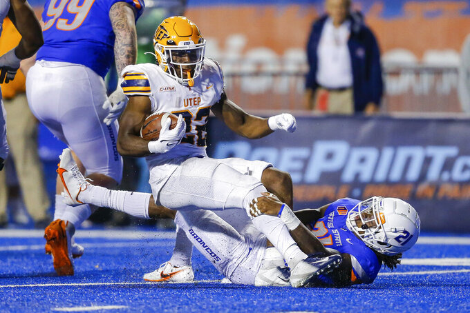 UTEP running back Ronald Awatt (22) is pulled down for a loss, by Boise State safety Tyreque Jones (21) duirng the first half of an NCAA college football game Friday, Sept. 10, 2021, in Boise, Idaho. (AP Photo/Steve Conner)