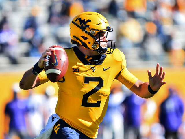 West Virginia  quarterback Jarret Doege (2) makes a pass against Kansas State during an NCAA college football game Saturday, Oct. 31, 2020, in Morgantown, W.Va. (William Wotring/The Dominion-Post via AP)