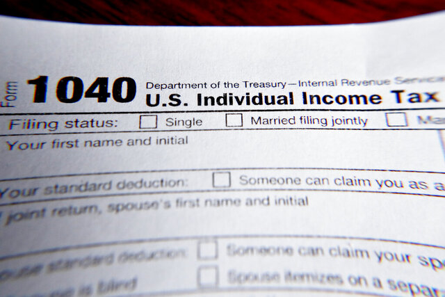 FILE - This Wednesday, Feb. 13, 2019 file photo shows part of a 1040 federal tax form printed from the Internal Revenue Service website, in Zelienople, Pa. Health insurance shoppers who used tax credits to buy coverage in 2020 still have a few weeks left to ward off an unpleasant tax surprise next spring. (AP Photo/Keith Srakocic)