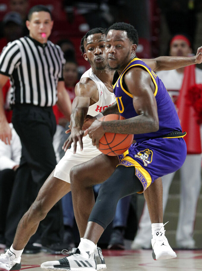 Houston guard Dejon Jarreau, left, reaches for the ball as East Carolina guard Isaac Fleming, right, pivots to the basket during the first half of an NCAA college basketball game Wednesday, Jan. 23, 2019, in Houston. (AP Photo/Michael Wyke)