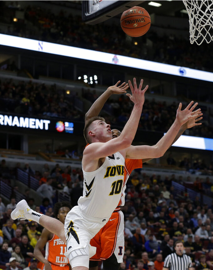 Iowa's Joe Wieskamp (10) takes a shot against Illinois's Aaron Jordan during the first half of an NCAA college basketball game in the second round of the Big Ten Conference tournament, Thursday, March 14, 2019, in Chicago. (AP Photo/Kiichiro Sato)