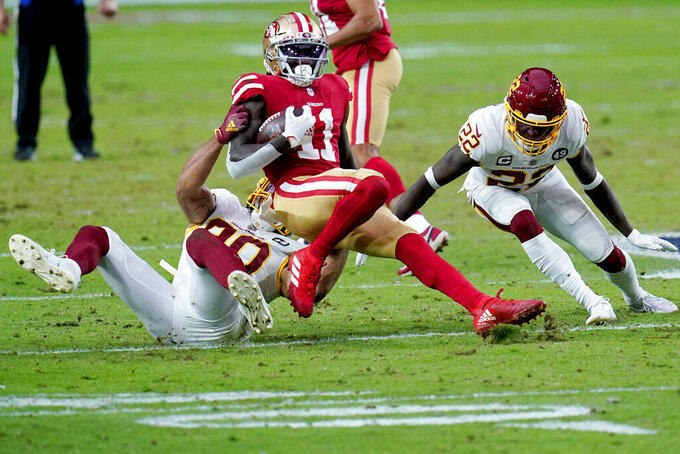 San Francisco 49ers wide receiver Brandon Aiyuk (11) is tackled by Washington Football Team cornerback Jimmy Moreland and free safety Deshazor Everett (22) during the first half of an NFL football game, Sunday, Dec. 13, 2020, in Glendale, Ariz. (AP Photo/Ross D. Franklin)