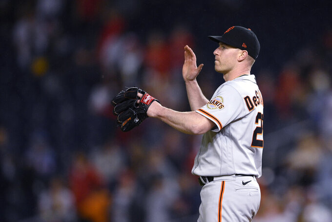San Francisco Giants starting pitcher Anthony DeSclafani reacts after the tema's baseball game against the Washington Nationals, Friday, June 11, 2021, in Washington. The Giants won 1-0. (AP Photo/Nick Wass)