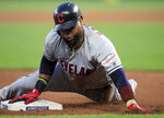 Cleveland Indians' Carlos Santana slides into third base, advancing on a fly out by Jason Kipnis during the fifth inning of the team's baseball game against the Kansas City Royals at Kauffman Stadium in Kansas City, Mo., Tuesday, July 2, 2019. (AP Photo/Orlin Wagner)