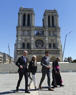 Canadian Prime Minister Justin Trudeau, second right, tours Notre Dame cathedral with Minister of Culture for France Franck Riester, left to right, Canadian Ambassador to France Isabelle Hudon and Monsignor Patrick Chauvet in Paris, France on Wednesday, May 15, 2019. (Adrian Wyld/The Canadian Press via AP)
