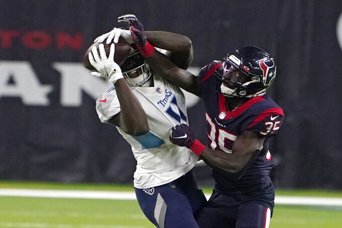 Tennessee Titans wide receiver A.J. Brown (11) catches a pass as Houston Texans' Keion Crossen (35) defends during the second half of an NFL football game Sunday, Jan. 3, 2021, in Houston. (AP Photo/Eric Christian Smith)