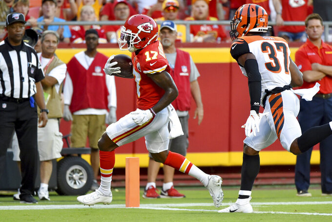 Kansas City Chiefs wide receiver Mecole Hardman (17) crosses into the end zone for a touchdown ahead of Cincinnati Bengals safety Demetrious Cox (37) during the first half of an NFL preseason football game in Kansas City, Mo., Saturday, Aug. 10, 2019. (AP Photo/Ed Zurga)