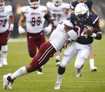 Connecticut running back Kevin Mensah (34) takes a hit from Massachusetts safety Brice McAllister during the first half of an NCAA college football game, Saturday, Oct. 27, 2018, in East Hartford, Conn.  (AP Photo/Jessica Hill)