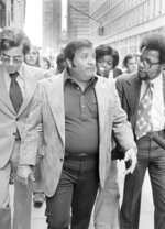 FILe - In this Sept. 4, 1975 file photo, Charles O'Brien,  Jimmy Hoffa's adopted son, leaves the federal court building in Detroit.  O'Brien, a longtime associate of the late Jimmy Hoffa who became a leading suspect in the Teamsters boss' disappearance, has died. O'Brien's stepson, Harvard Law School professor Jack Goldsmith, said in a blog post that O'Brien died Thursday, Feb. 13m 2020 in Boca Raton, Fla., from what appeared to be a heart attack. (AP Photo/Richard Sheinwald, File)