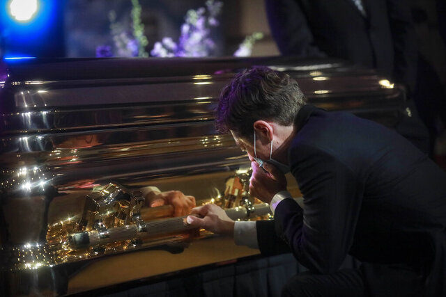 Minneapolis Mayor Jacob Frey kneels and weeps by the casket of George Floyd before funeral services at North Central University, Thursday, June 4, 2020, in Minneapolis. Floyd died on May 25 as a Minneapolis police officer pressed his knee into his neck, ignoring his cries and bystander shouts until he eventually stopped moving. (AP Photo/Bebeto Matthews)