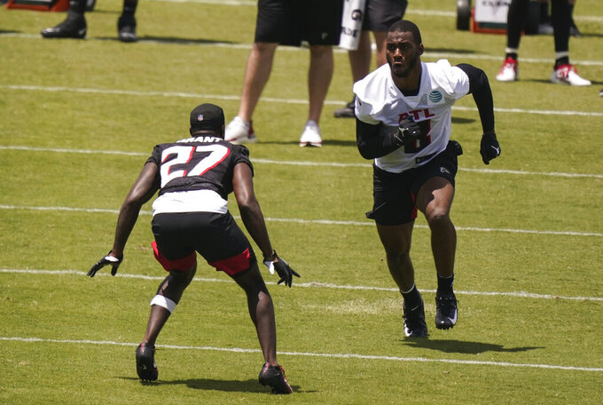 Atlanta Falcons' Kyle Pitts, right, practice with Richie Grant, left, during an NFL football rookie minicamp on Friday, May 14, 2021, in Flowery Branch, Ga. (AP Photo/Brynn Anderson)