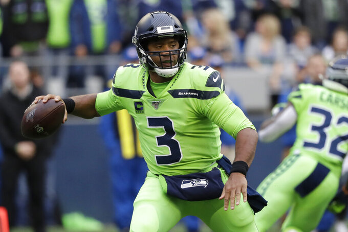 Seattle Seahawks quarterback Russell Wilson drops back to pass against the Los Angeles Rams during the first half of an NFL football game Thursday, Oct. 3, 2019, in Seattle. (AP Photo/Elaine Thompson)