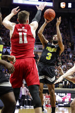 Purdue guard Jahaad Proctor (3) shoots over Wisconsin forward Micah Potter (11) during the second half of an NCAA college basketball game in West Lafayette, Ind., Friday, Jan. 24, 2020. (AP Photo/Michael Conroy)