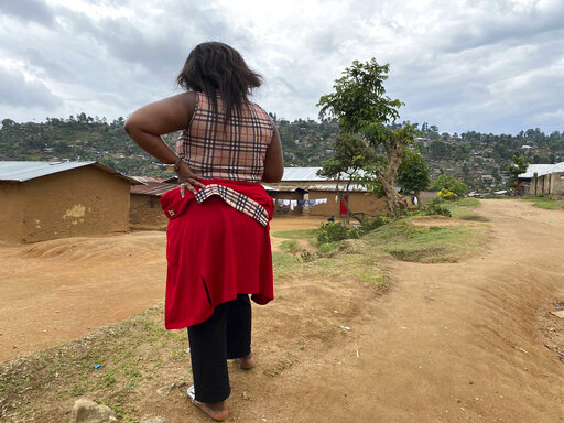 FILE - In this Thursday, March 18, 2021 file photo, Shekinah stands near her home in Beni, eastern Congo. A panel commissioned by the World Health Organization on Tuesday Sept, 28, 2021 identified more than 80 alleged cases of sex abuse during the U.N. health agency's response to an Ebola outbreak in Congo, including allegations implicating 20 WHO staff members. (AP Photo/Kudra Maliro, File)
