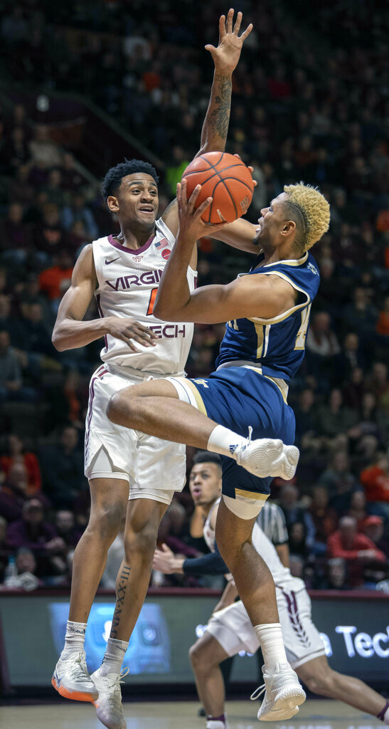 Georgia Tech guard Brandon Alston (4) shoots against Virginia Tech guard Nickeil Alexander-Walker (4) during the first half of an NCAA college basketball game Wednesday, Feb. 13, 2019, in Blacksburg, Va. (AP Photo/Don Petersen)
