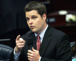 FILE - In this May 1, 2014, file photo, Rep. Matt Gaetz, R-Fort Walton Beach, answers questions about the medical marijuana bill during session in Tallahassee, Fla. Before Gaetz rose to national prominence as an ardent backer of Donald Trump, he carved out an unusual reputation in Florida: a Republican lawmaker who wanted to liberalize marijuana laws. (AP Photo/Steve Cannon, File)