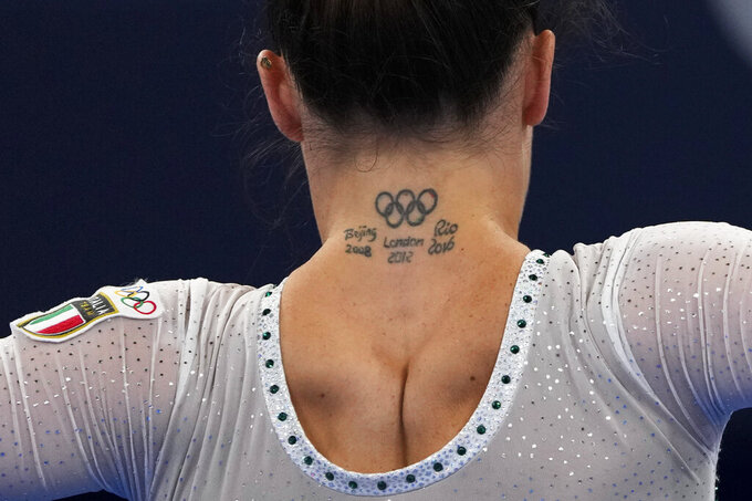 Vanessa Ferrari, of Italy, performs during the women's artistic gymnastic qualifications at the 2020 Summer Olympics, Sunday, July 25, 2021, in Tokyo. (AP Photo/Natacha Pisarenko)