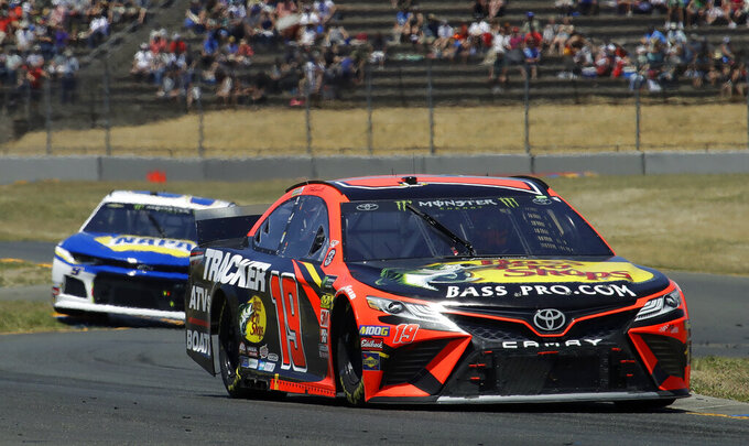 Martin Truex Jr., right, leads Chase Elliott through a turn during a NASCAR Sprint Cup Series auto race Sunday, June 23, 2019, in Sonoma, Calif. (AP Photo/Ben Margot)