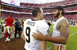 FILE - In this Nov. 6, 2016, file photo, San Francisco 49ers quarterback Colin Kaepernick, right, is greeted by New Orleans Saints quarterback Drew Brees at the end of an NFL football game in Santa Clara, Calif. As athletes and sports organizations around the world speak out against racial injustice in the wake of George Floyd's death, Drew Brees drew sharp criticism after he reiterated his opposition to Colin Kaepernick's kneeling during the national anthem in 2016. (AP Photo/D. Ross Cameron, File)