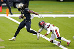 New Orleans Saints running back Alvin Kamara (41) scores a touchdown against Tampa Bay Buccaneers safety Antoine Winfield Jr. (31) in the first half of an NFL football game in New Orleans, Sunday, Sept. 13, 2020. (AP Photo/Brett Duke)
