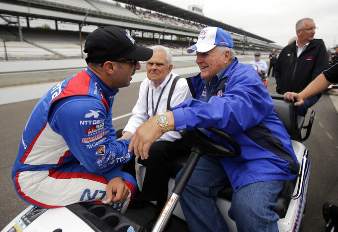FILE - In this May 16, 2015, file photo, Tony Kanaan, left, of Brazil, talks with car owner and four-time Indianapolis 500 champion AJ Foyt on the first day of qualifications for the Indianapolis 500 auto race at Indianapolis Motor Speedway in Indianapolis. Organizers announced Thursday, March 26, the 500 would move from its traditional Memorial Day weekend slot to Aug. 23. Drivers, like fan favorite Kanaan, jumped right on board — calling it the right move. Foyt issued a statement saying IndyCar officials were doing the best they could under unforeseen circumstances. (AP Photo/Darron Cummings, File)